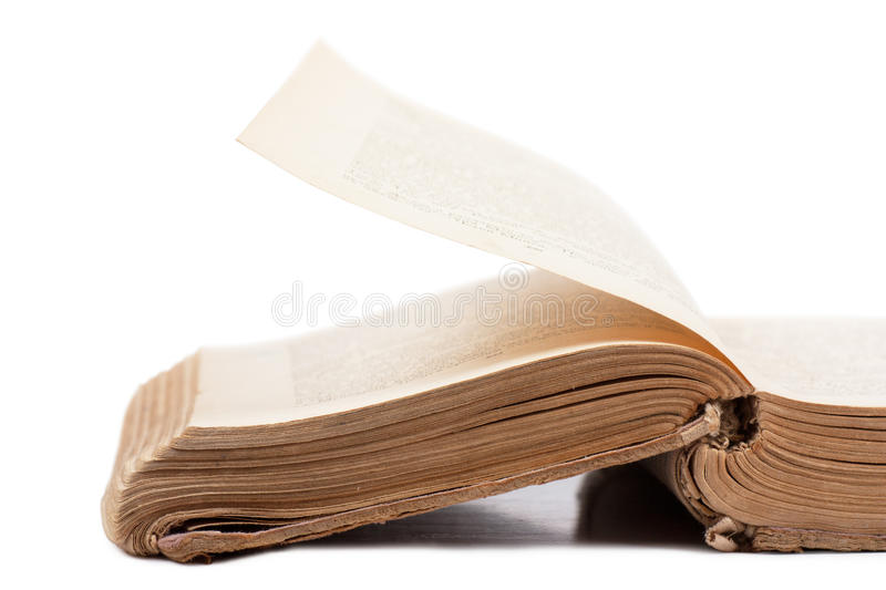 Old book. Thick old used book over white background stock photography
