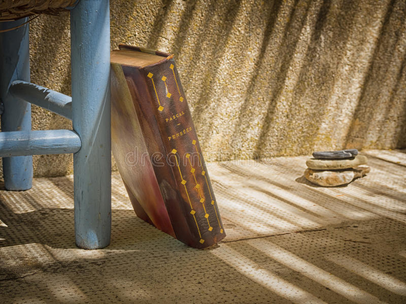 Old book against a chair royalty free stock photos