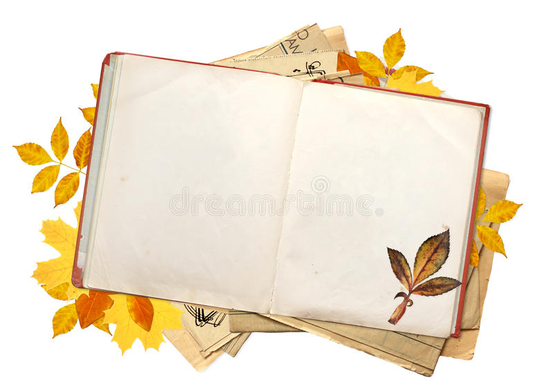 Old book with blank pages and multi-colored autumn leaves. Objects isolated on white background. Copy space for your text stock photo