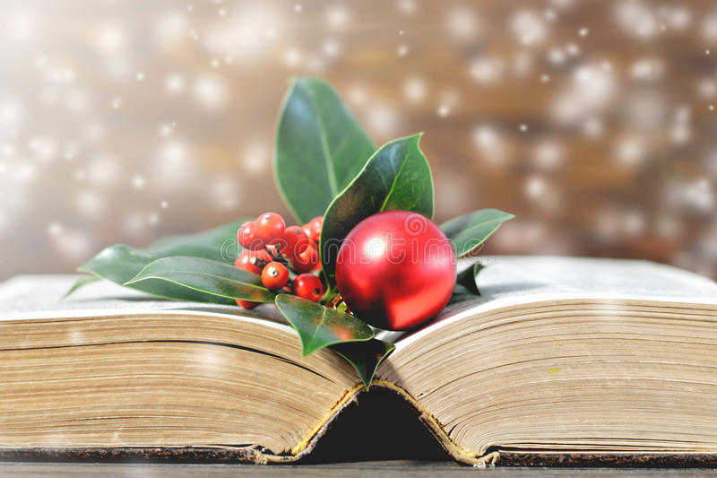 Old book and Christmas decoration royalty free stock image