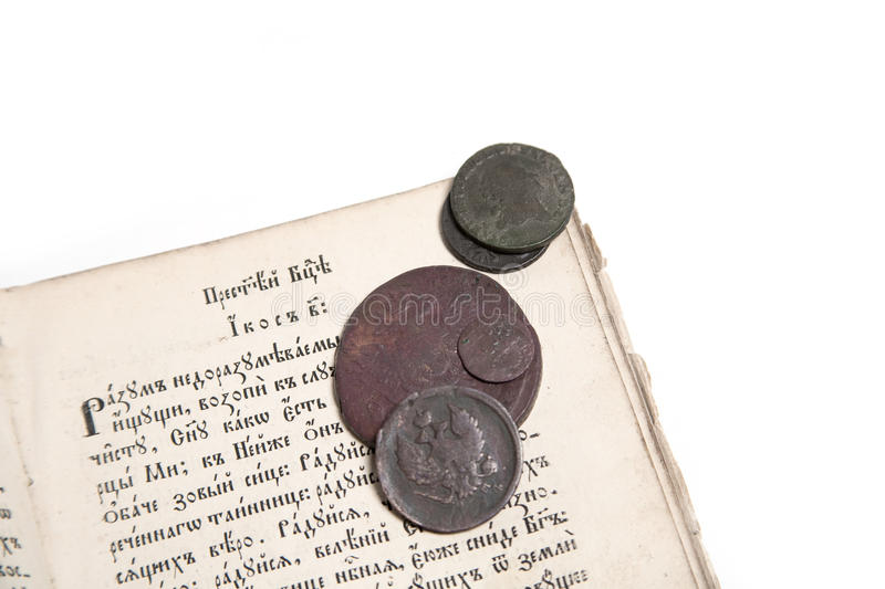 Old Book And Coins Royalty Free Stock Photography