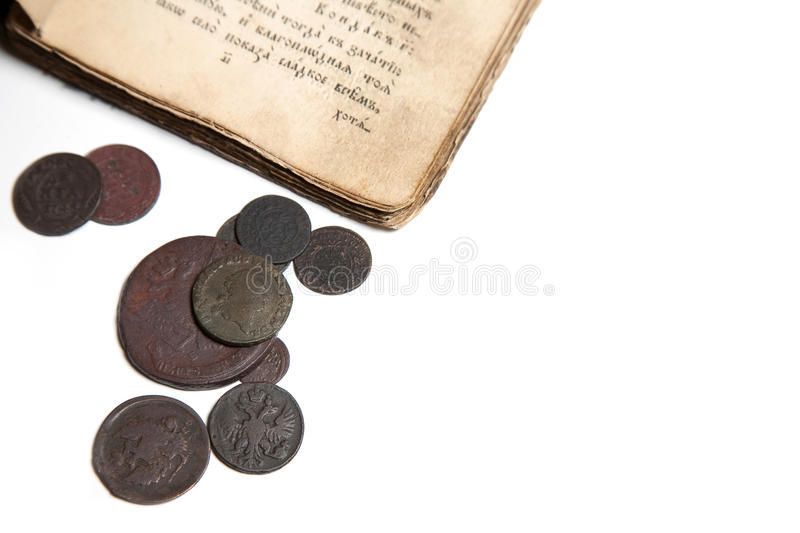 Old book and coins royalty free stock photos