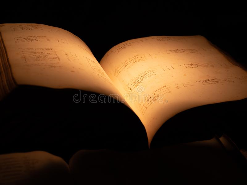 Old book pages. Old book in dark backround 1885 19th century abstract academic aged ancient antiquarian antique antiques archive art books candle canvas card royalty free stock photography