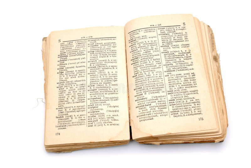 The old book - the dictionary. The open old book - the dictionary on a white background stock photo