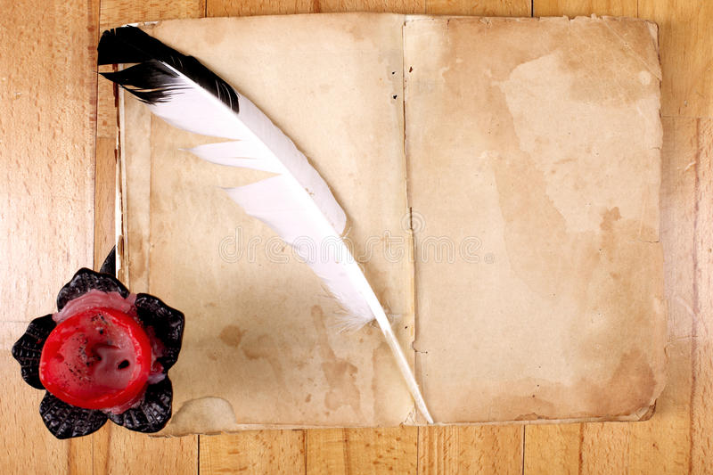 Download Old Book With Feather Pen And Candle Stock Photo - Image: 13083390