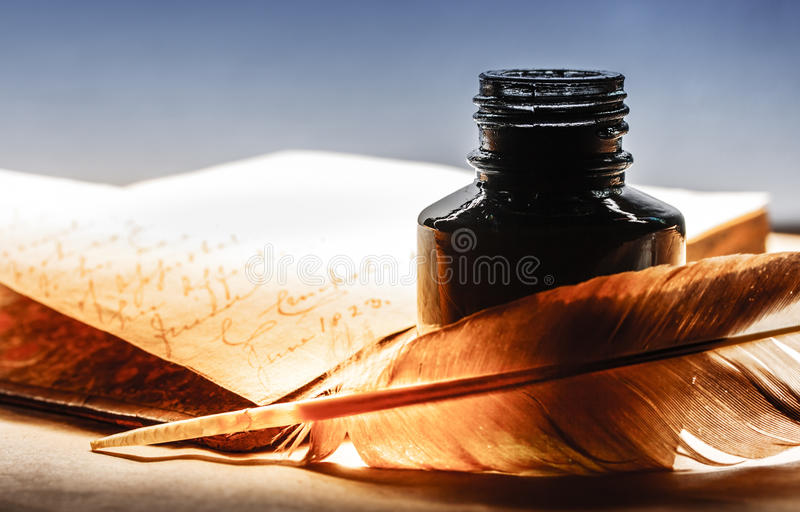 Old book with feather pen royalty free stock images