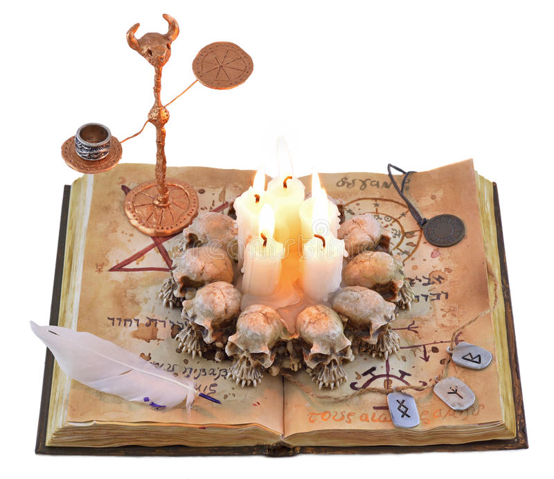 Magic book with candles and runes royalty free stock photos