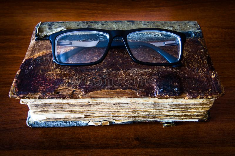 Old Book with a Glasses royalty free stock photography