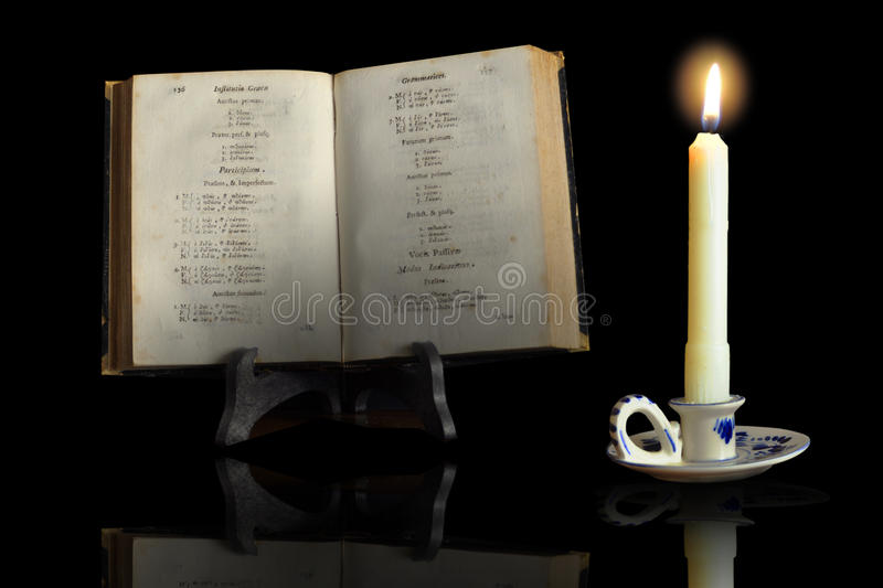Download An Old Book In The Light Of A Candle Stock Image - Image: 20046983