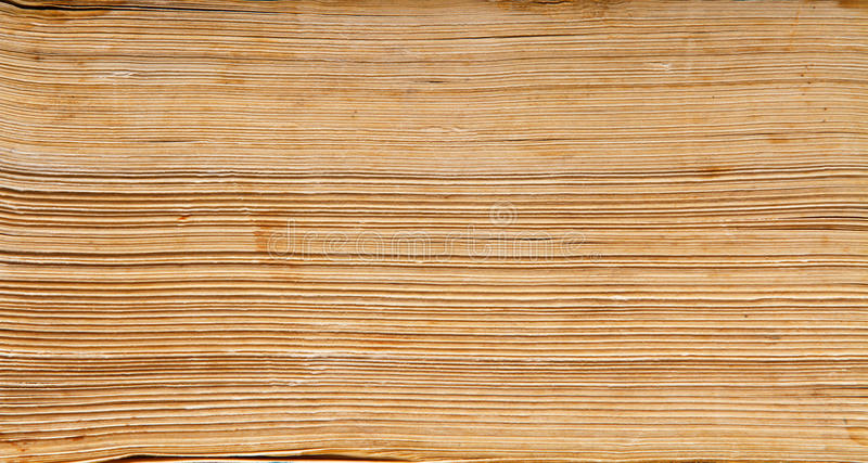 Old book paper background, macro of spine pages royalty free stock photo