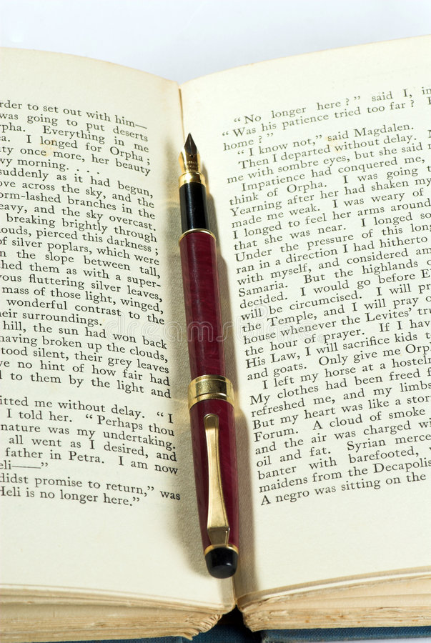 Old book & pen. Old english book with old old pen stock photography