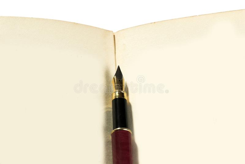 Old book & pen royalty free stock images