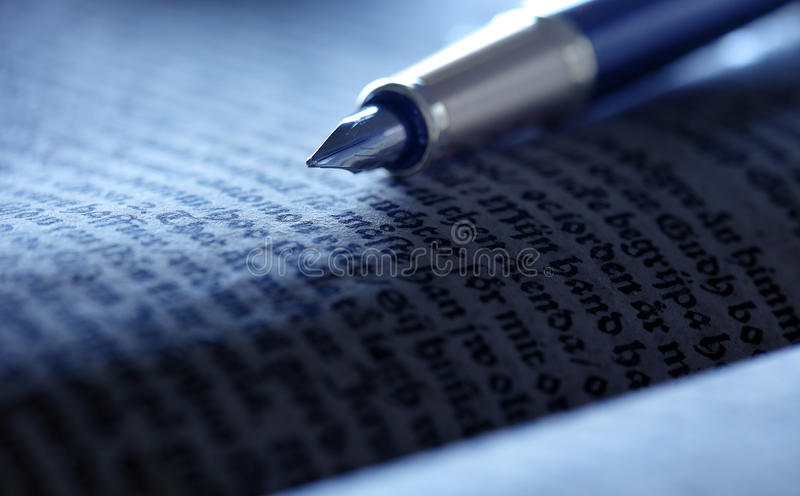Old book and pen royalty free stock image