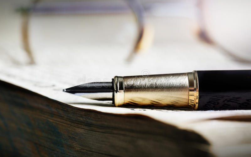 Old book and pen royalty free stock photo