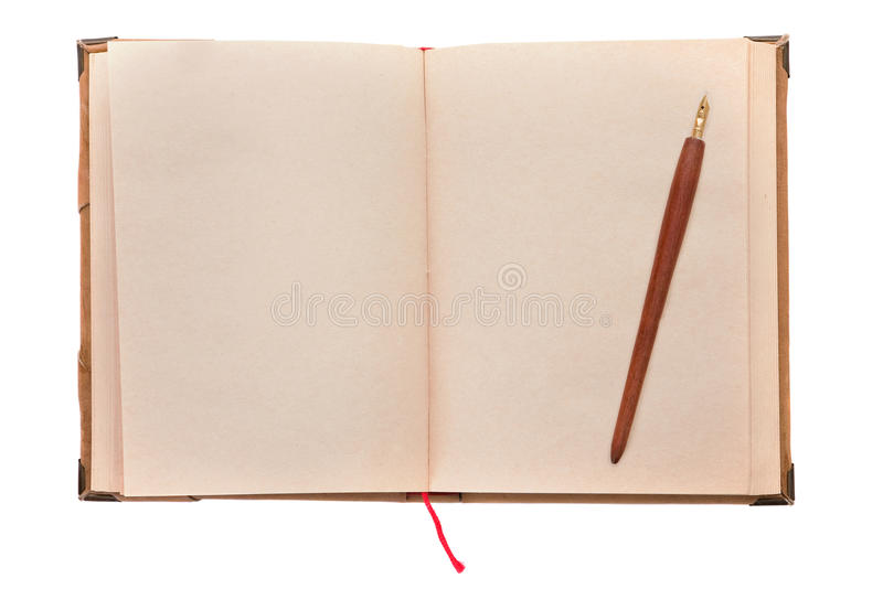 Old book and pen. Close up on white background with copyspace royalty free stock image