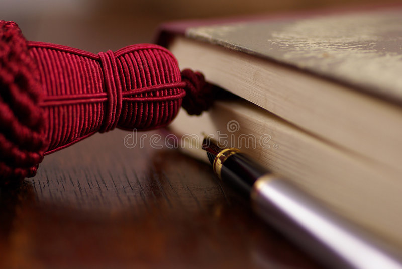Old Book and Pen. Old book with old fashioned bookmark and fountain pen stock images