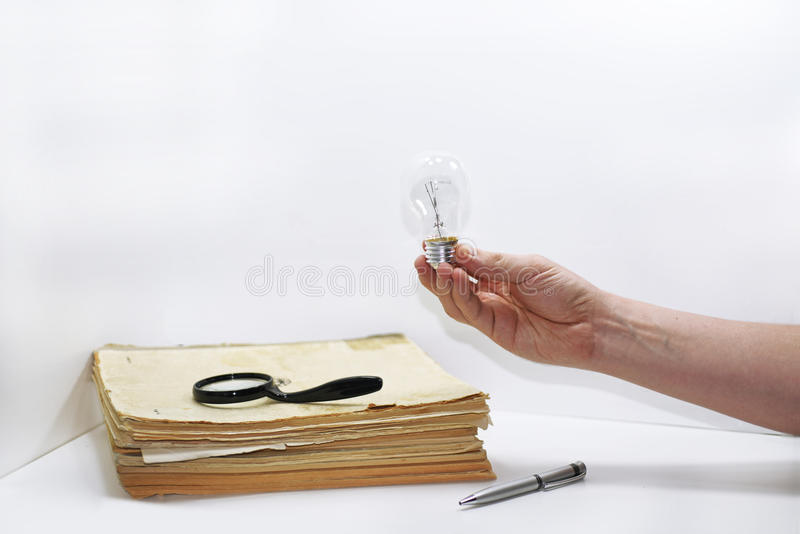 Old book with pen. Abstract composition of idea creating. Isolated documents on white background royalty free stock photos
