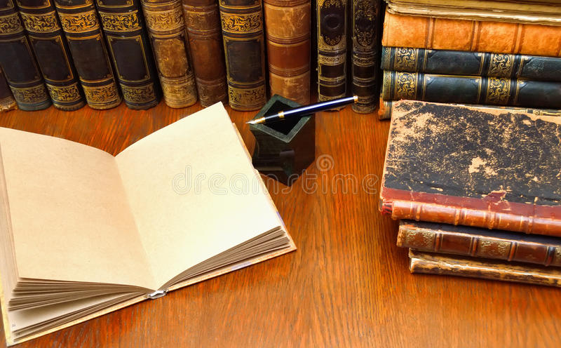 Old book, pen and ink on the table. Old book, pen and inkwell on the table royalty free stock image