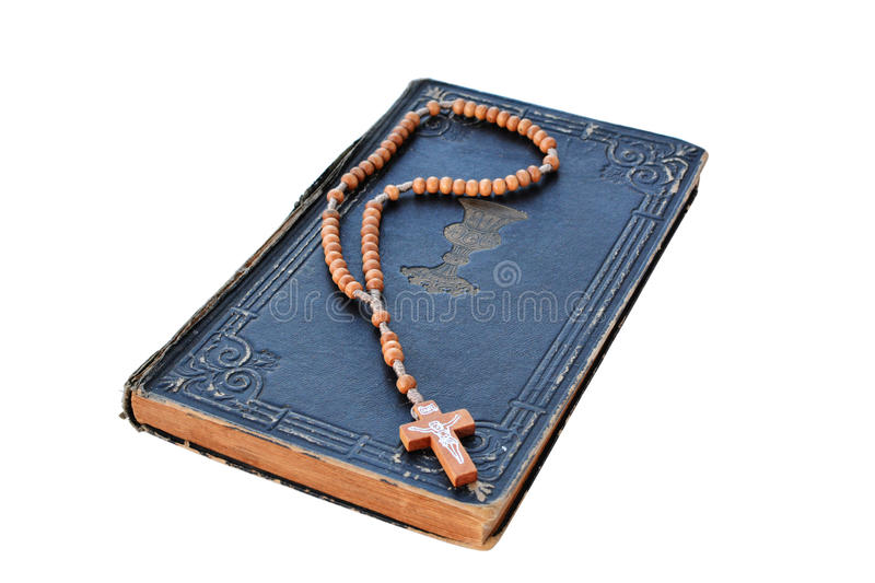 Old Book of Psalms and rosary isolated. On white background stock photo