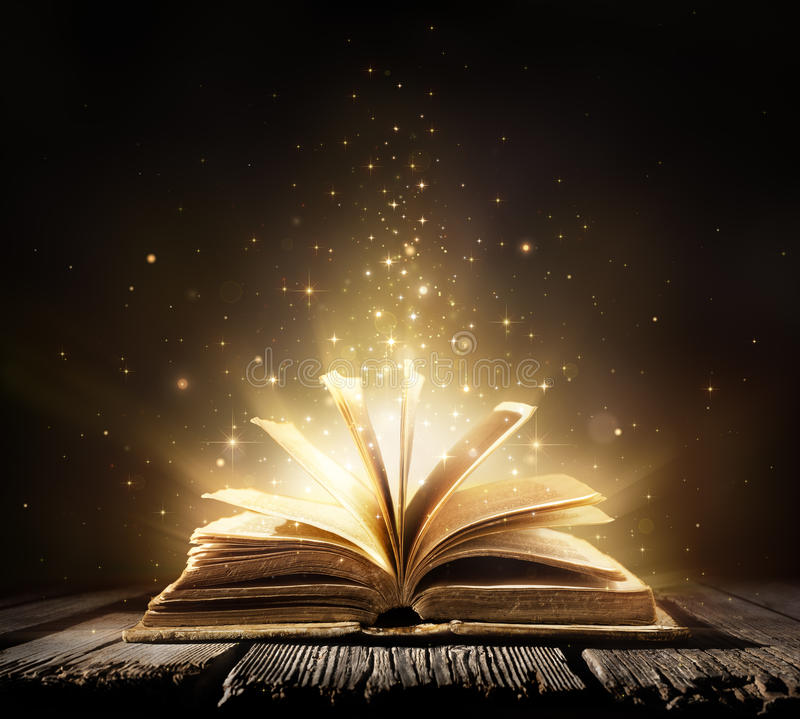 Free Old Book With Magic Lights Royalty Free Stock Photo - 68635545