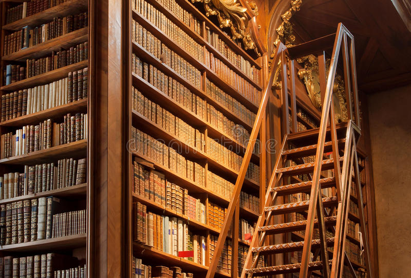 Old bookcase with the leather-bound book covers in the library of Vienna. Austria stock images