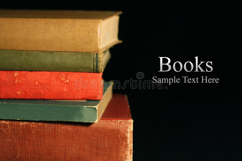 Old Books. Closeup of stacked old books with room for text on side royalty free stock images