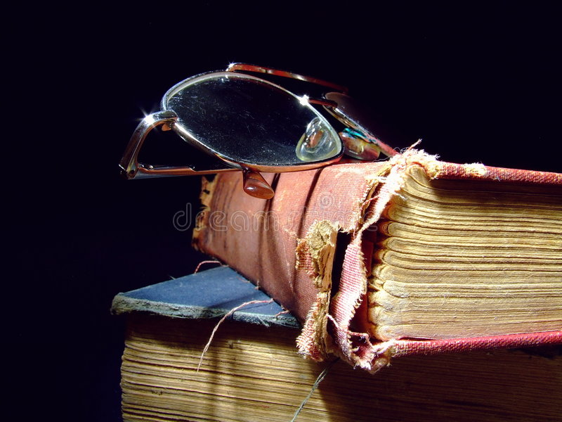 Old Books. Close-up of two old and tattered books royalty free stock image