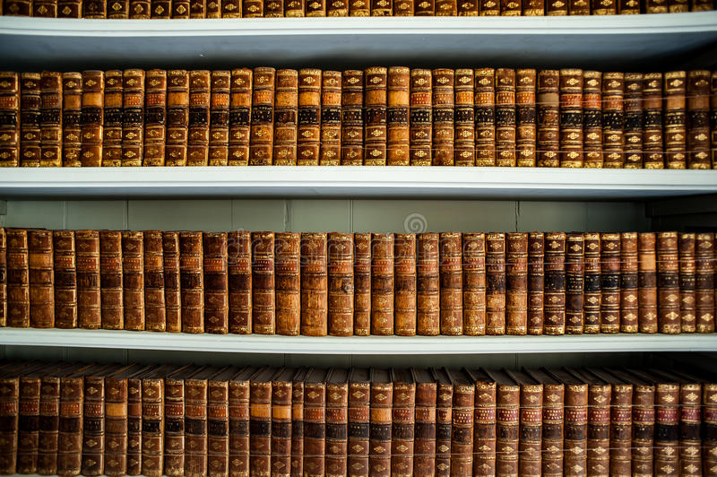 Old books in an ancient library stock photography
