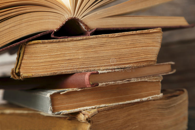 Old books. Old antique books on grey wooden table stock photos