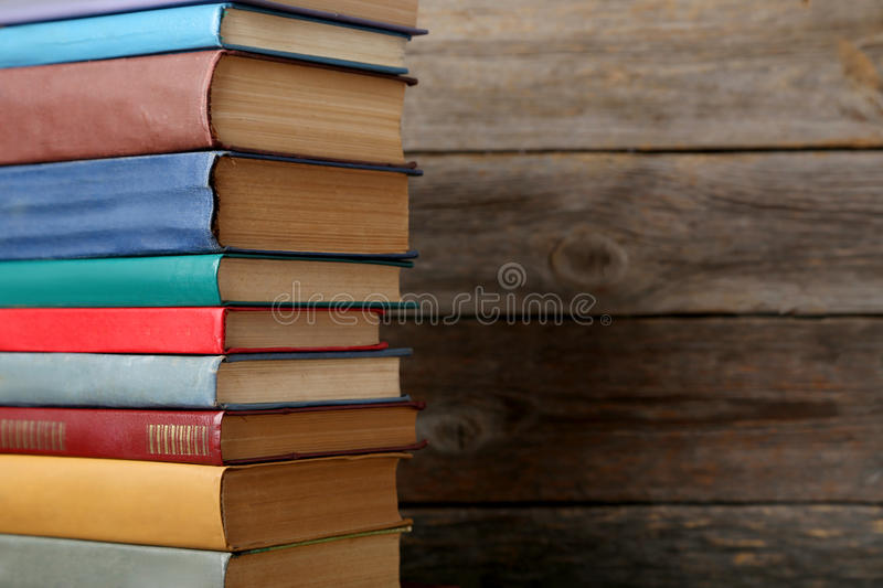 Old books. Old antique books on grey wooden table royalty free stock image