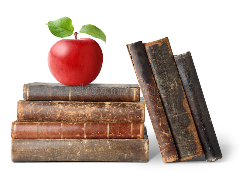 Old books and apple stock images