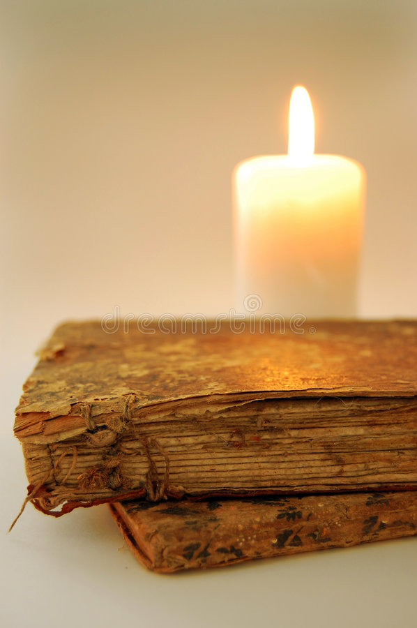Old Books by the Candle royalty free stock photos