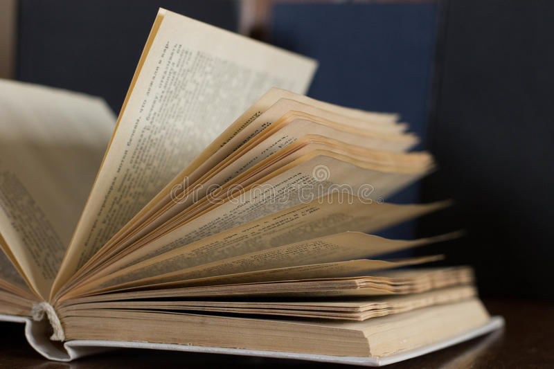 Old books on a chair stock image
