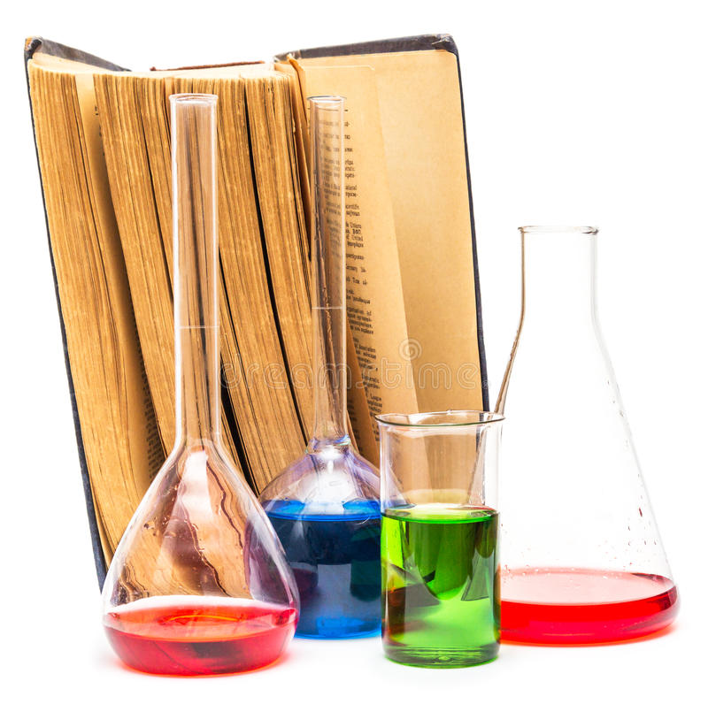 Old books and chemical glassware stock photography