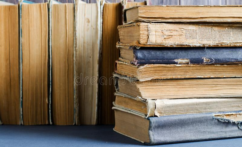 Old books with crumpled, torn covers. Close up stock photo