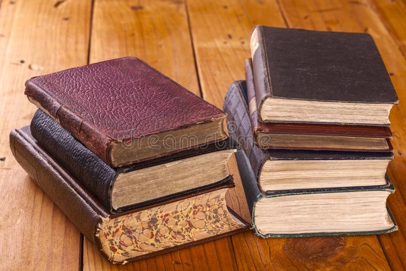 Old Books 0n Rustic Pine Table stock images