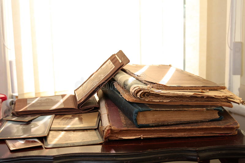Old books, newspapers and photos; stock photo