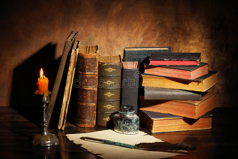 Old books. Pile of the old books and a quill royalty free stock image