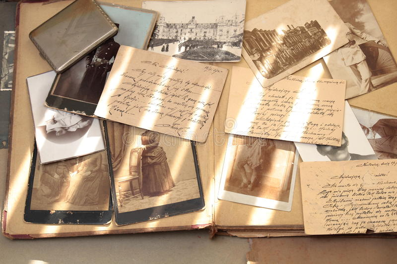 Old books, postcards, letters and photos. Correspondence, postcards and photos over hundred years old on on beige book background stock image