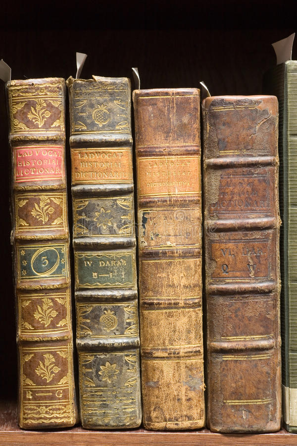 Old books on the shelf stock image