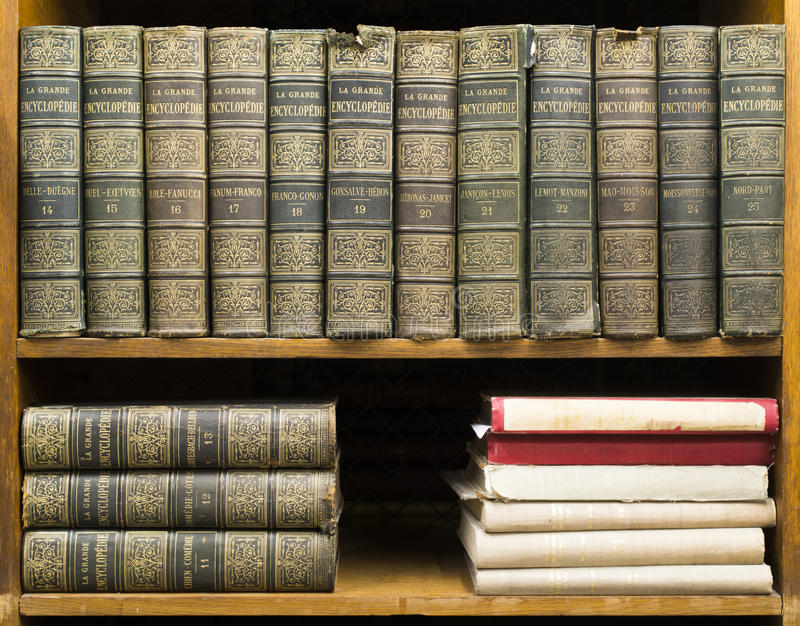 Old books on shelf royalty free stock photos