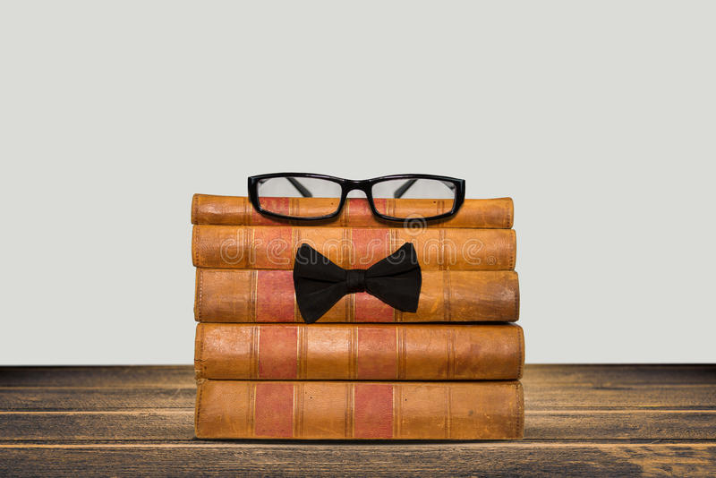 Download Old Books Shelf Isolated On Wooden Table Stock Photo - Image: 83705223