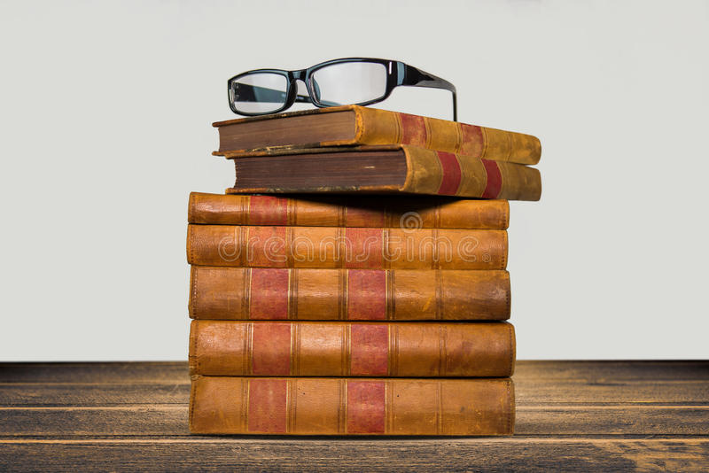 Download Old Books Shelf Isolated On Wooden Table Stock Photo - Image: 83705445