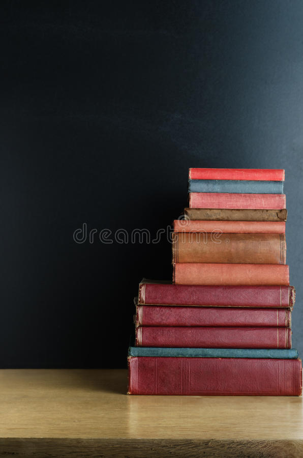 Old Books Stacked on Desk stock photography