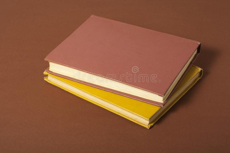 Old books on wooden desk. Back to school. Education background. royalty free stock image