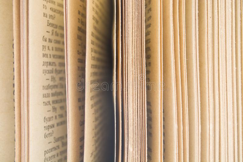 Old books on a white background. the turned yellow old pages. Home library. stock photo