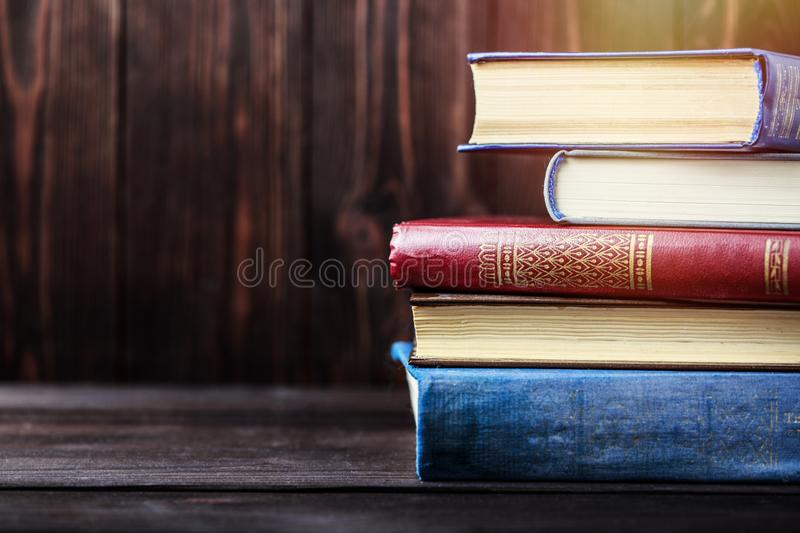 Old books on wooden background. The source of information. Books indoor. Home library. Knowledge is power royalty free stock image