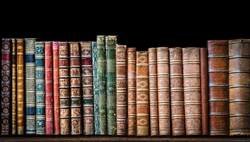Old books on wooden shelf royalty free stock images