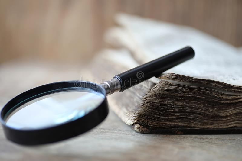 Download Old Books On A Wooden Table And Magnifier Stock Photo - Image of investigation, magnifier: 100877154