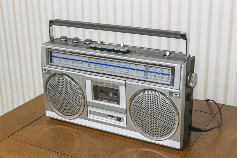 Old Boom Box on Table. Old boom box radio cassette recorder on wood table royalty free stock photo